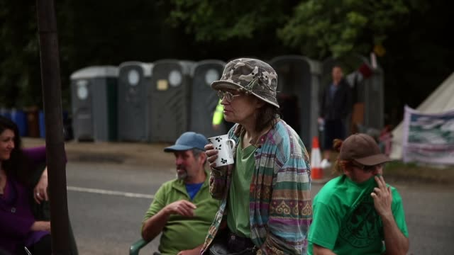mid shot, protestor drinking a hot drink. protesters gather outside a drill site operated by cuadrilla resources ltd on august 19, 2013 in balcombe,... - west sussex stock videos & royalty-free footage