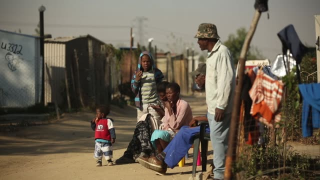 mid shot residents of diepsloot township go about their daily activities as they pass the public holiday following youth day on june 17 2013 in... - soweto stock videos & royalty-free footage