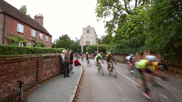 mid shot riders pass through the small village of puttenham during stage seven of the tour of britain from epsom racecourse to guildford on september... - tour of britain stock videos & royalty-free footage