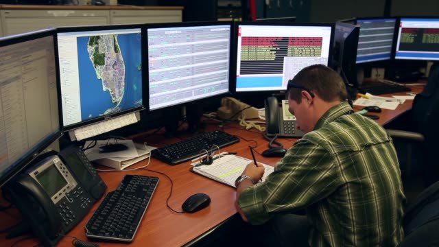 mid shot robert thompson a control room operator keeps an eye on the system as he participates in a hurricane response exercise at the south florida... - practice drill stock videos & royalty-free footage