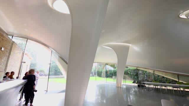 vídeos y material grabado en eventos de stock de mid shot, serpentine sackler gallery interior. members of the public admire the redeveloped serpentine sackler gallery in hyde park on september 25,... - jeremy paxman
