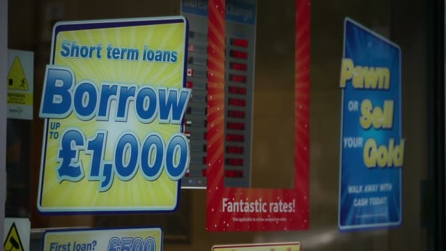 mid shot short term loan advert payday loan stores are to face tougher regulations after moves proposed by the financial conduct authority call on... - pawnbroker stock videos & royalty-free footage