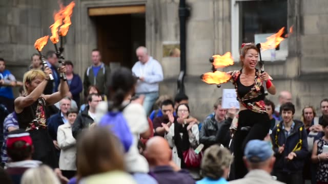 mid shot, street performers juggling with flaming rods. street entertainers perform on edinburgh's royal mile during the city's festival fringe on... - performer stock videos & royalty-free footage