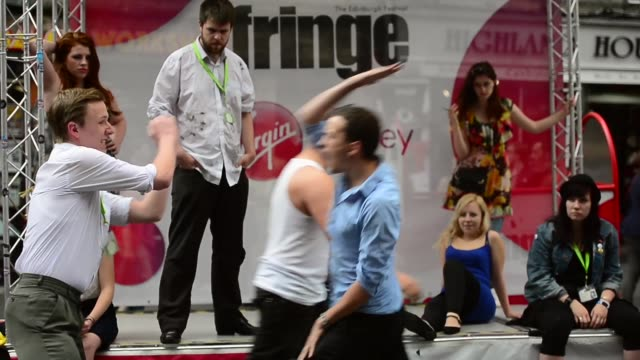 mid shot, street performers teaching street fight. street entertainers perform on edinburgh's royal mile during the city's festival fringe on august... - performer stock videos & royalty-free footage