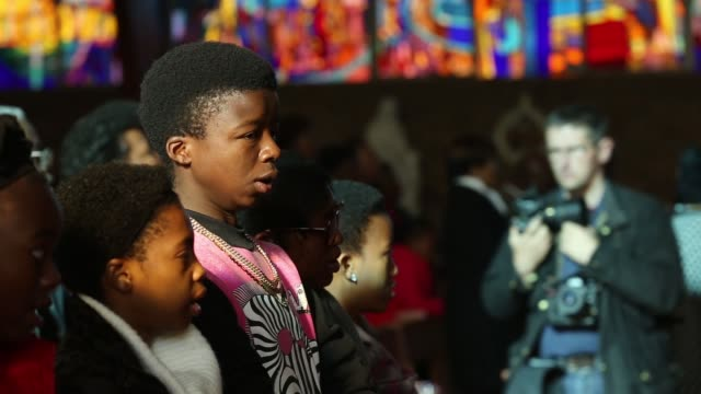 mid shot, the congregation pray during a sunday service at regina mundi church in soweto on june 16, 2013 in johannesburg, south africa. youth day... - ハウテング州点の映像素材/bロール