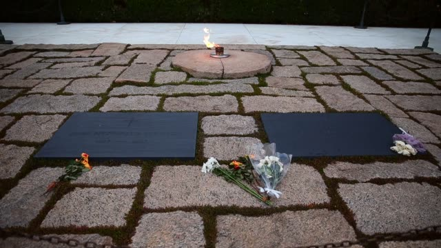 mid shot the eternal flame burns at the gravesite of the 35th president of the united states john f kennedy at arlington national cemetery in... - grab stock-videos und b-roll-filmmaterial