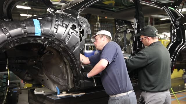 mid shot, the new nissan qashqai is produced on the assembly line at the nissan sunderland plant on january 22, 2014 in sunderland, england. the... - 4x4 video stock e b–roll