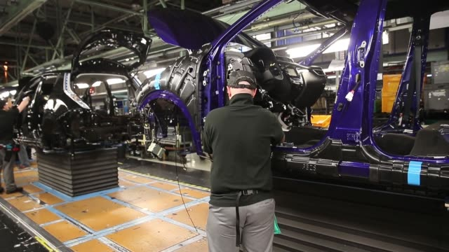mid shot the new nissan qashqai is produced on the assembly line at the nissan sunderland plant on january 22 2014 in sunderland england the qashqai... - sports utility vehicle stock-videos und b-roll-filmmaterial