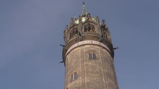 mid shot  - tower of castle church / schlosskirche with golden letters - christianity stock videos & royalty-free footage
