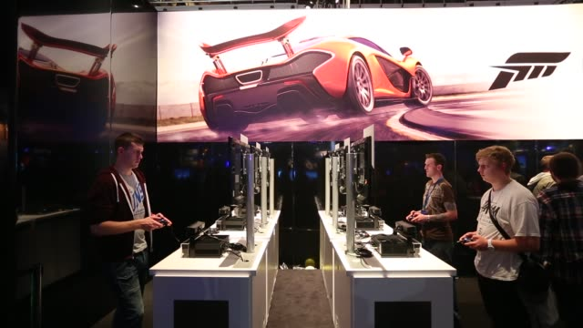 mid shot, video game enthusiasts play the latest release games at the eurogamer expo at earls court exhibition centre on september 26, 2103 in... - earls court stock videos & royalty-free footage