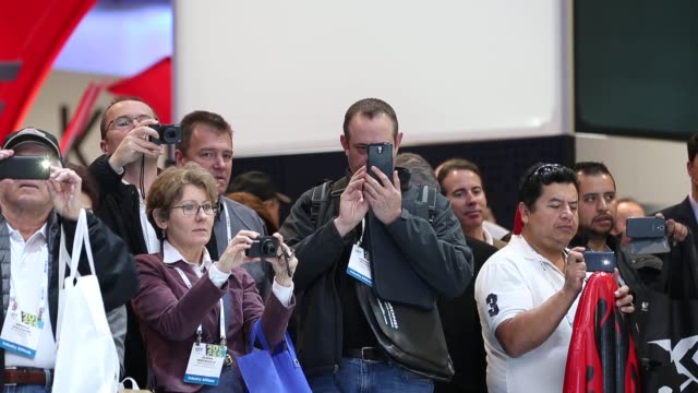 Mid Shot visitors photograph Toyota's IROAD trike General views of the 2014 International Consumer Electronics Show in Las Vegas Nevada CES the...