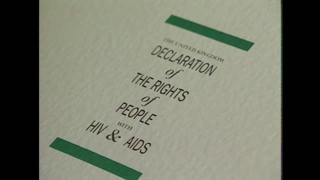 mid shot zoom out of a document titled ''united kingdom declaration of the rights of people with hiv & aids'' as pages are turned. this document was... - zoom out stock videos & royalty-free footage