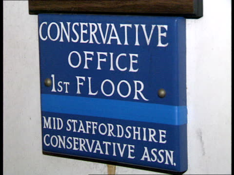 mid staffs byelection leadup ext night conservative offices with lights on int day cannock council meeting in progress cannock district council... - lichfield stock videos & royalty-free footage