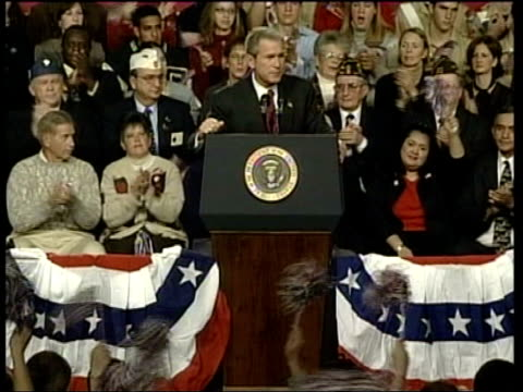 stockvideo's en b-roll-footage met campaigning itn usa pennsylvania harrisburg presidential plane landing on runway la lms george w bush down steps from plane zoom in int vox pops bush... - george w. bush