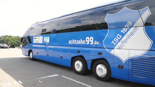 mid tracking shot, hoffenheim team bus arriving at imtech arena. . - 1899 stock videos & royalty-free footage