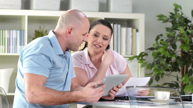 HD: Mid-Adult Couple Using Tablet Computer