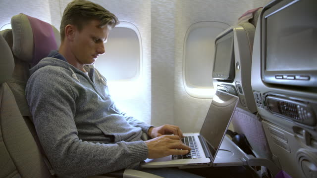 MS Mid-adult man using laptop on the airplane