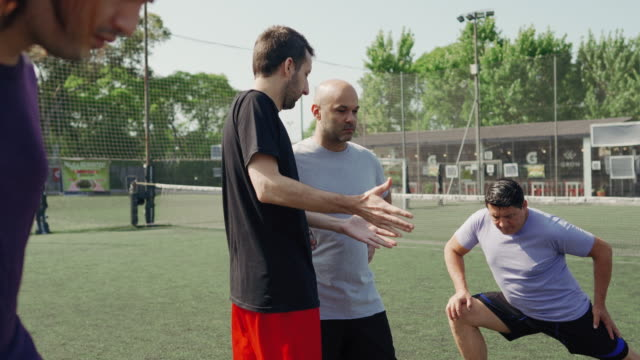 mid-adult men stretching before soccer game - mid adult men stock videos & royalty-free footage