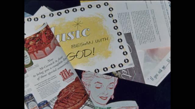 mid-century magazine ads, paper ephemera falling upward through frame - table top view stock videos & royalty-free footage