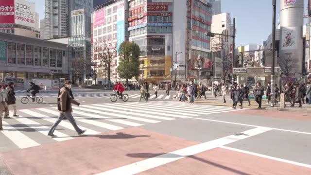 midday shibuya crossing at tokyo, japan - editorial stock videos & royalty-free footage