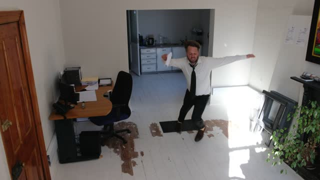 middle adult man with papers trips and falls in the office - blooper film clip stock videos & royalty-free footage