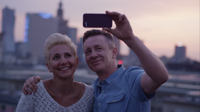 middle age couple in love making a selfie - mature couple stock videos & royalty-free footage