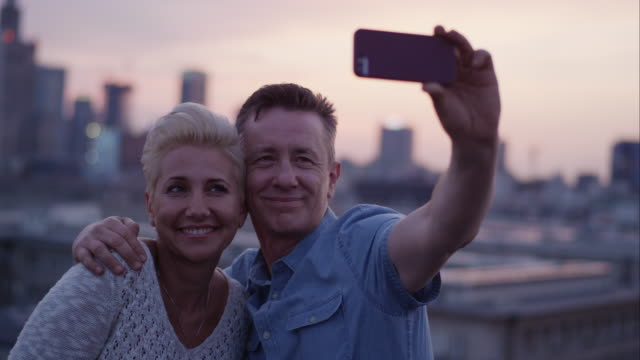 Middle age couple in love making a Selfie