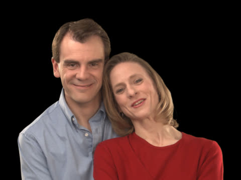 middle age couple smiling - this clip has an embedded alpha-channel - pre matted stock-videos und b-roll-filmmaterial