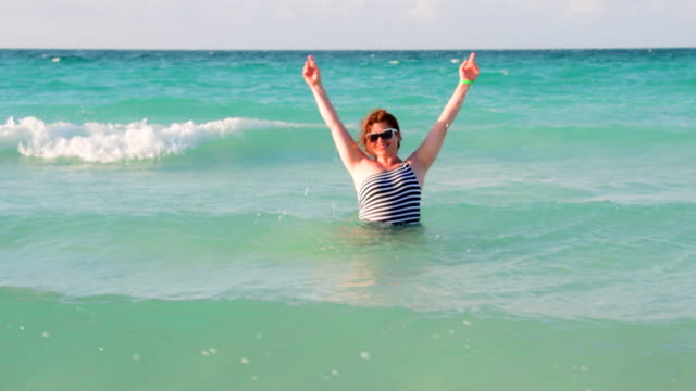 middle age woman enjoying a tropical beach, varadero, cuba - varadero stock videos and b-roll footage
