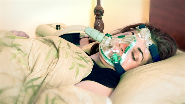 middle age woman suffering from sleep apnea - sleep apnea stock videos and b-roll footage