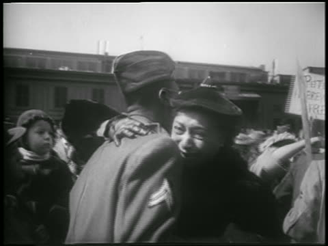 middle aged black woman hugging soldier outdoors / korean war homecoming / newsreel - adult offspring stock videos & royalty-free footage