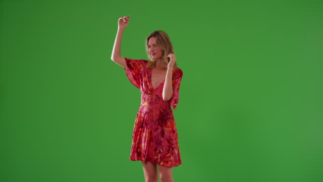 middle aged caucasian woman in sundress dancing on green screen - entertainment occupation stock videos and b-roll footage
