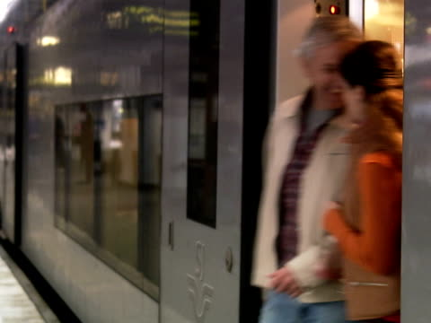 a middle aged couple arriving to a train station sweden. - bahnreisender stock-videos und b-roll-filmmaterial