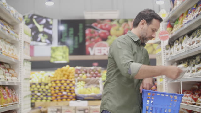 middle aged man shopping at the supermarket - modern manhood stock videos & royalty-free footage