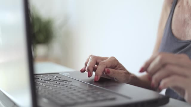 middle aged woman hands using laptop - hot desking stock videos & royalty-free footage