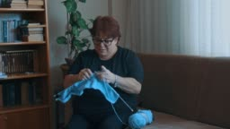 Middle aged woman knitting