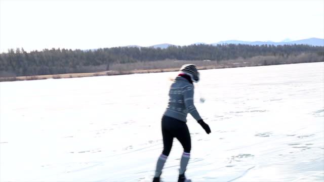 vídeos y material grabado en eventos de stock de middle aged woman skates on frozen lake - patinaje sobre hielo