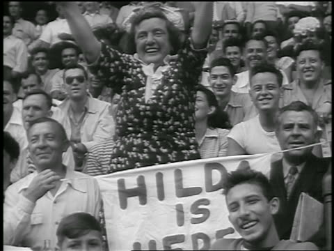 middle aged woman standing + cheering at ebbets field / brooklyn, ny / newsreel - 1947 stock videos & royalty-free footage