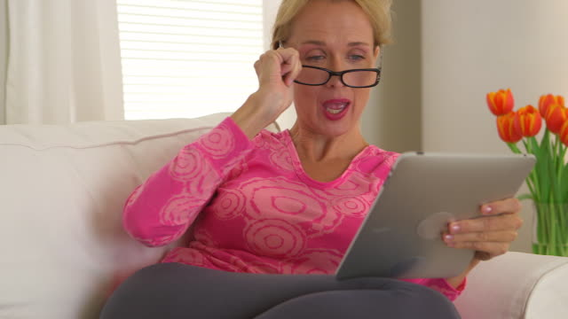 Middle Aged woman using tablet computer