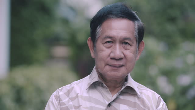 middle class senior adult portrait. asian. serious look. - one senior man only stock videos & royalty-free footage