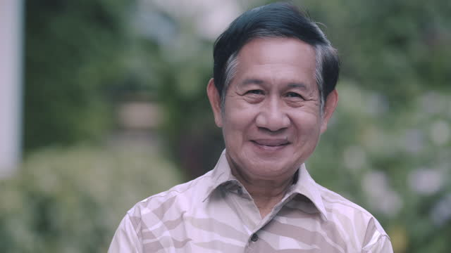 middle class senior adult portrait. asian. smiling. - one senior man only stock videos & royalty-free footage