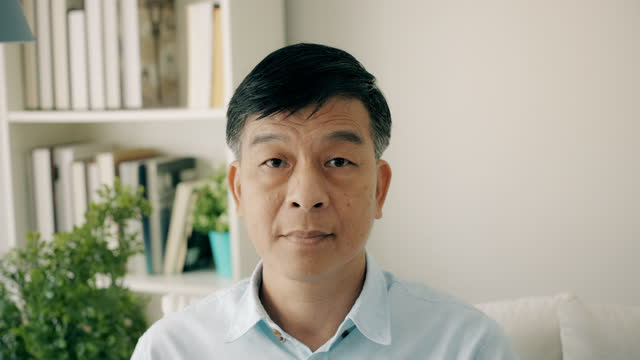 middle class senior portrait. asian. handheld orbit. - one senior man only stock videos & royalty-free footage