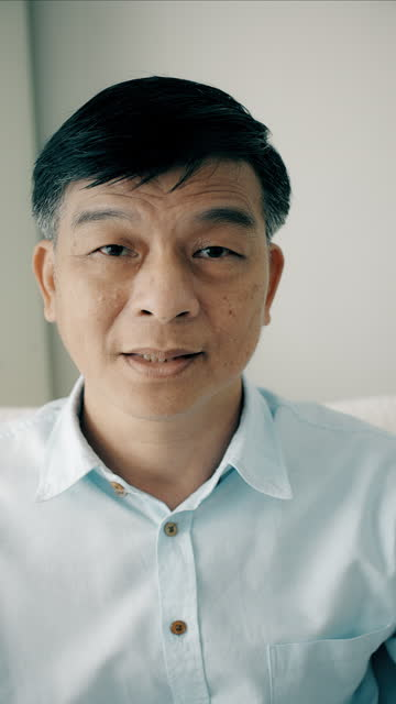 middle class senior portrait. asian. handheld vertical. - one senior man only stock videos & royalty-free footage