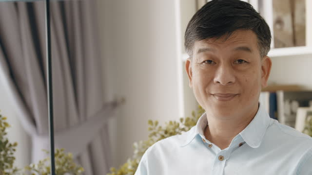middle class senior portrait. asian. happy smile. - one senior man only stock videos & royalty-free footage