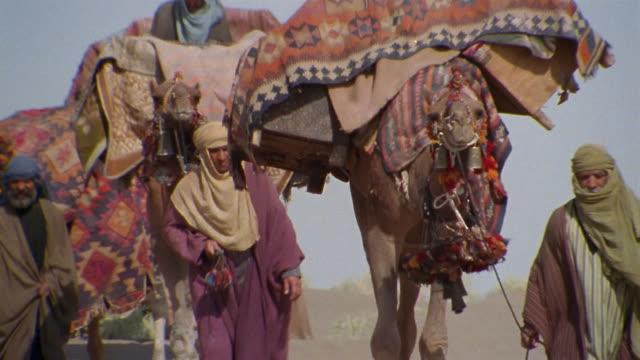 CU, TD, TU, Middle East, Bedouins leading camels through desert