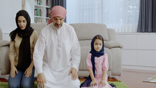 middle east family pray to god. facing camera. - praying stock videos & royalty-free footage