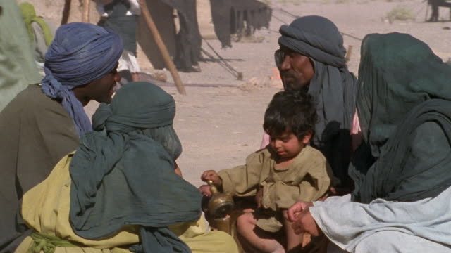 cu, pan, middle east, four men with boy (3-4) in desert camp - see other clips from this shoot 1007 stock videos & royalty-free footage