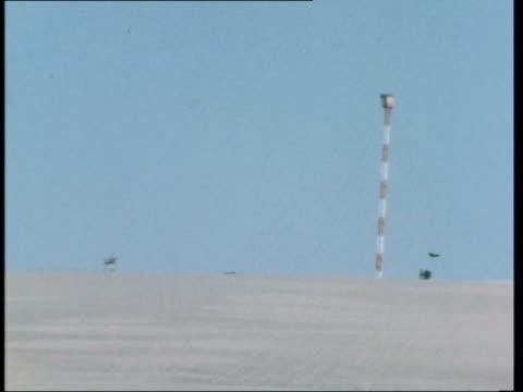 Sinai GV Terrain TS War debris PAN sign 'Stop' TRACK along road from edge of buffer Zone to Tel Aviv GV Tower MS UN border post MS Sign 'UN Zone NO...