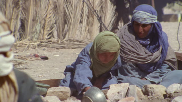 cu, middle east, mother with son (12-13) in desert camp - iran stock videos and b-roll footage