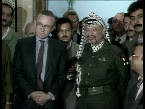 Tunis Douglas Hogg MP as shakes with PLO leader Yasser Arafat for press CMS Arafat MS Yasser Arafat and Douglas Hogg MP intvwd SOT as standing next...